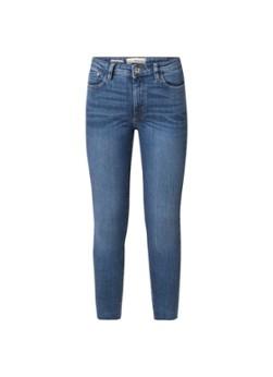 MANGO Isa mid waist skinny jeans met verwassen look