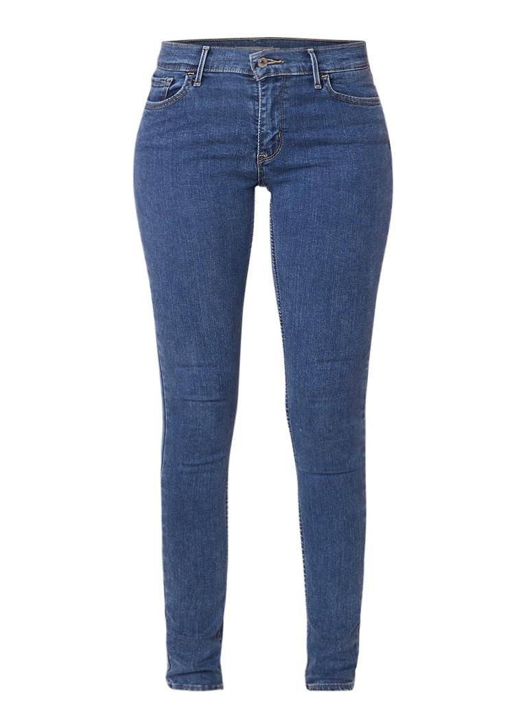 Levi's 710 Innovation mid rise super skinny jeans met medium wassing