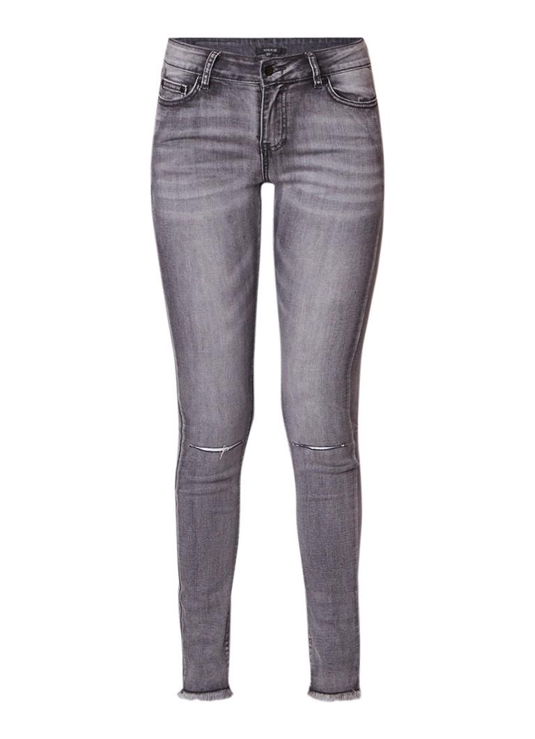 NIKKIE Betty mid rise skinny jeans met destroyed look