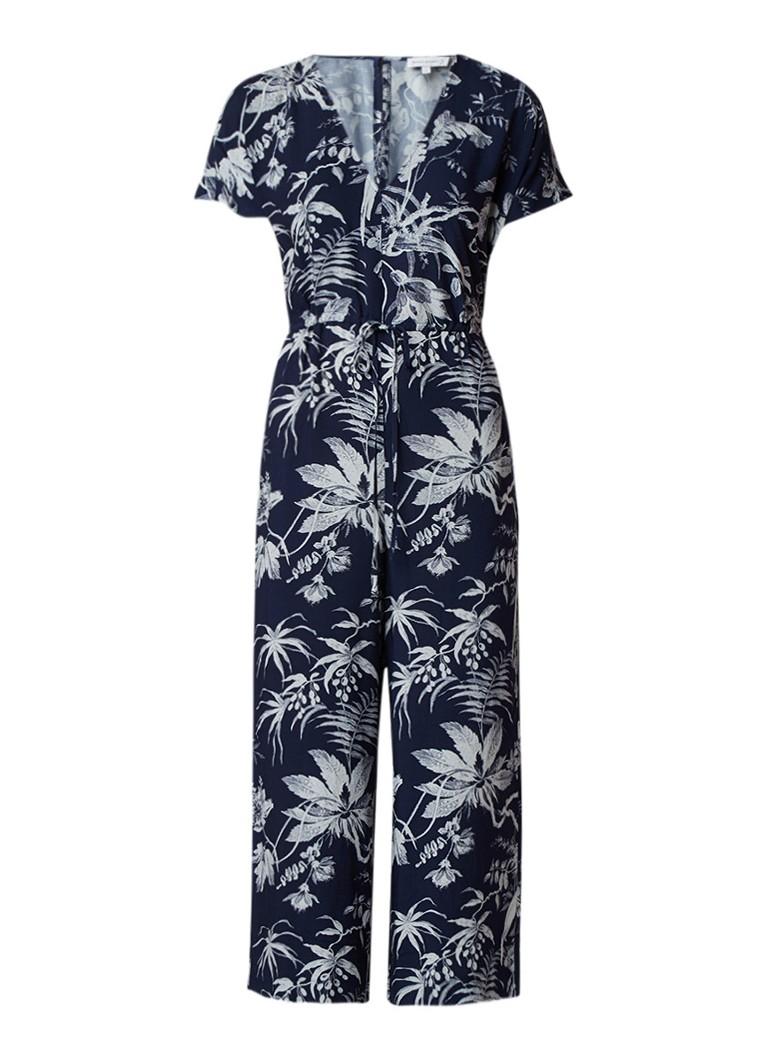 Warehouse Wide fit 7 8 jumpsuit met bladdessin en ceintuur