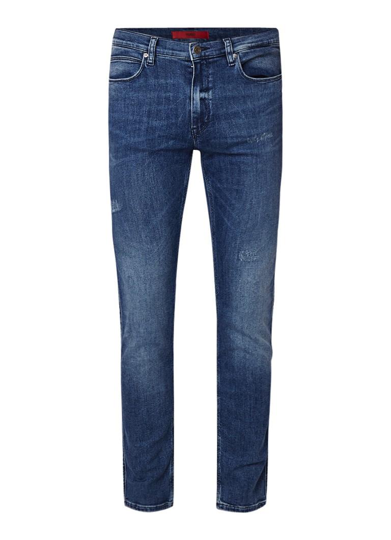 Image of HUGO BOSS 734 mid rise slim fit jeans met destroyed details