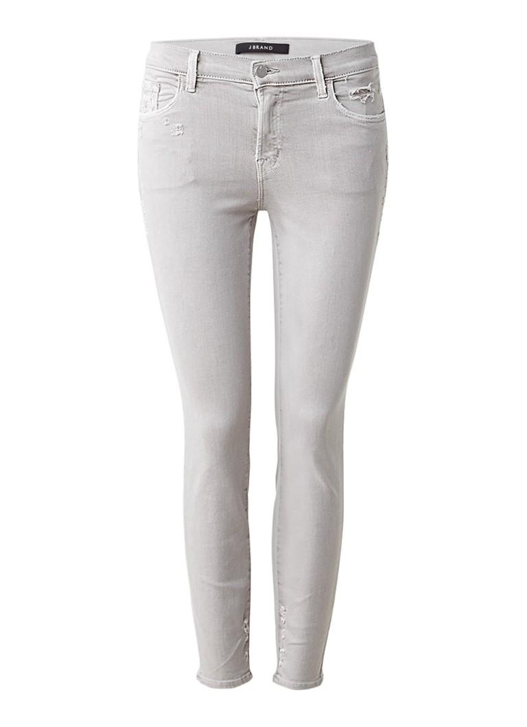 J Brand Mid rise cropped skinny jeans met destroyed details