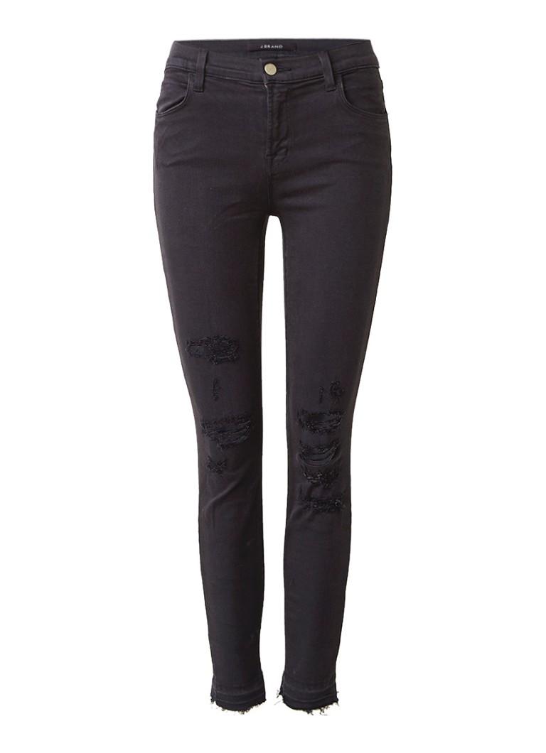 J Brand Skinny Leg mid rise jeans met ripped details