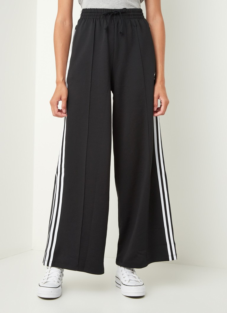 adidas - High waist wide fit track pants met logo - Zwart