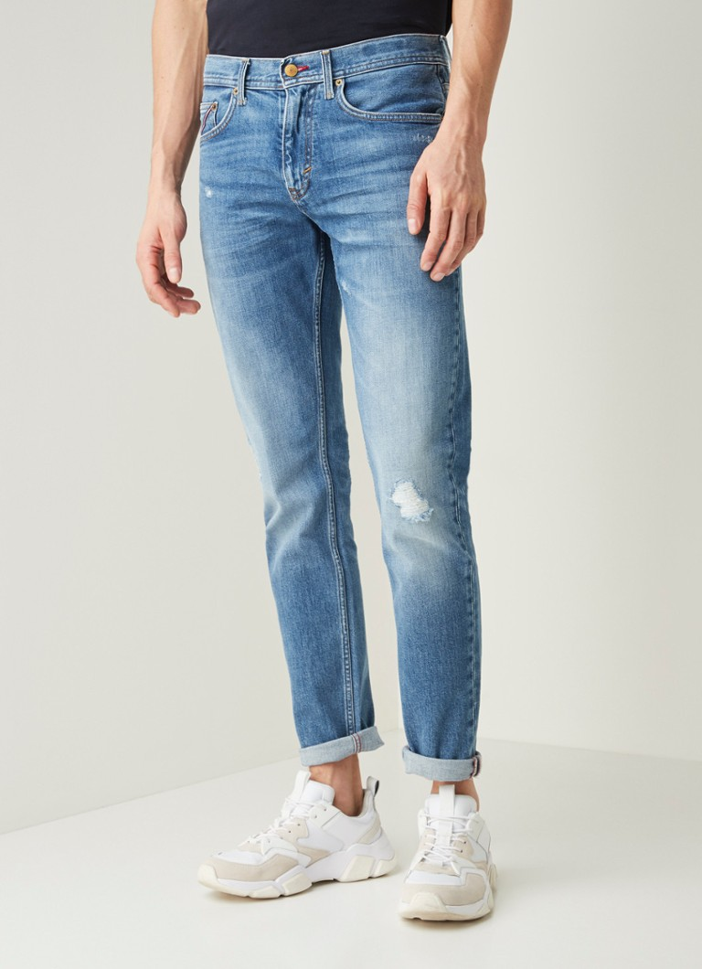 Tommy Hilfiger - Tapered fit jeans met ripped details - Indigo